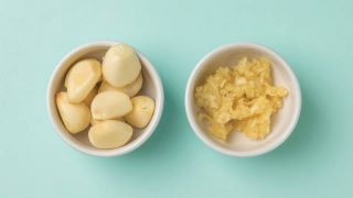 garlic cloves and mashed garlic in a bowl