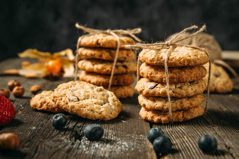 packs of lactation cookies with bow and blueberries on the table