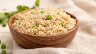wooden bowl with quinoa and peas