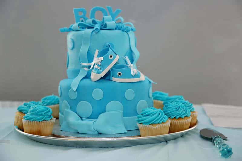 sweet blue baby boy shower cake on the table