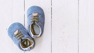 blue toddler shoes for flat feet on white wooden floor