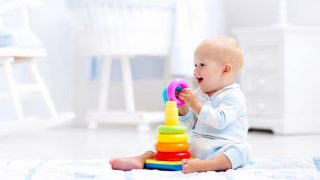 cute baby boy playing with educational toy