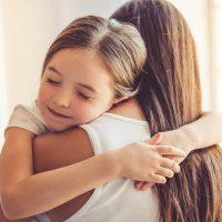 adorable little girl hugging her stepmother
