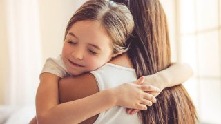 adorable little girl hugging her stepmother