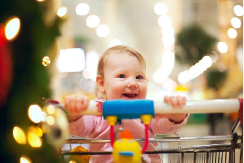 Beautiful baby girl in shopping