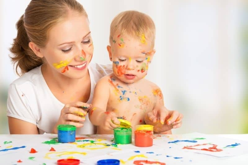 mother and baby finger painting