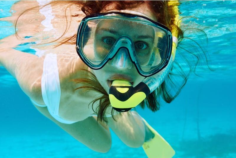 Woman snorkeling in clear water