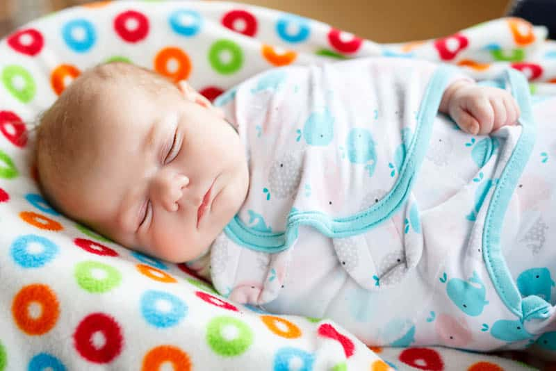 adorable swaddled baby sleeping tight