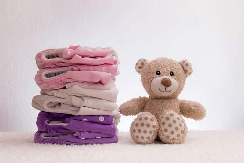 baby cloth panties with teddy bear toy on the floor
