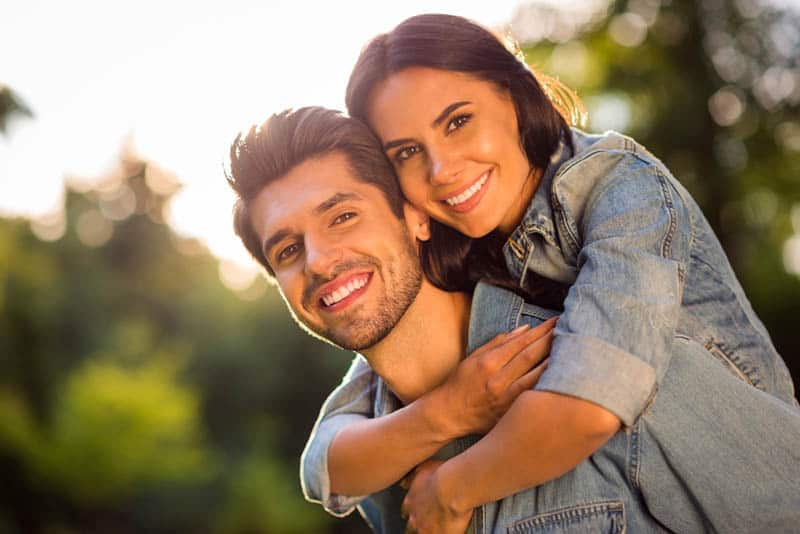 beautiful couple hugging on a sunny day