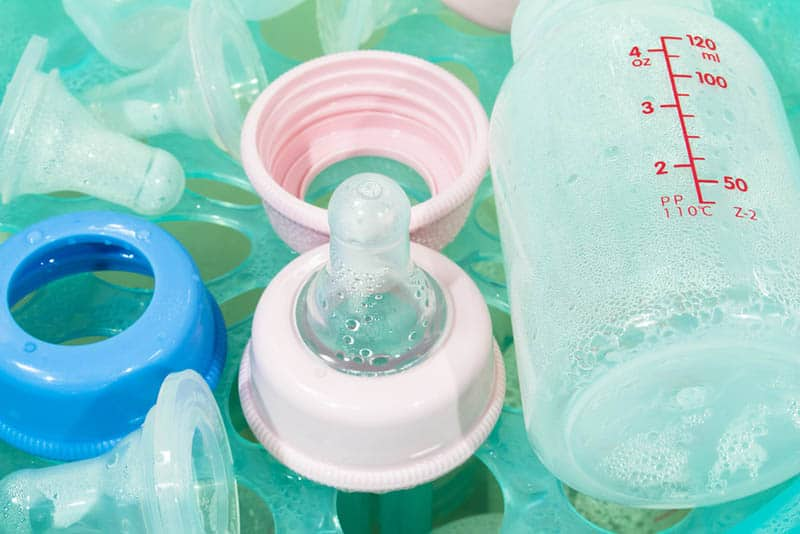 cleaning baby bottles in the water