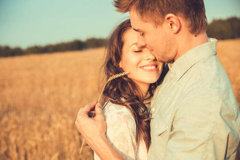 couple in love standing in the field