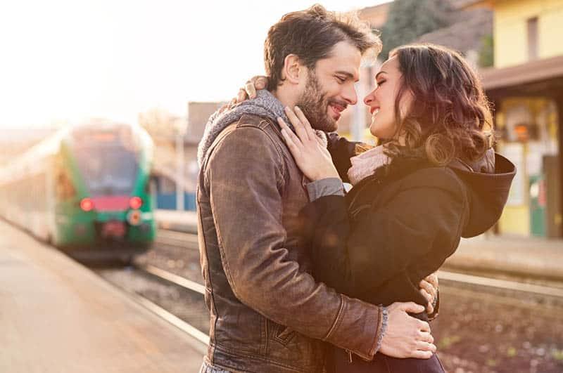 loving couple hugging on the railway station