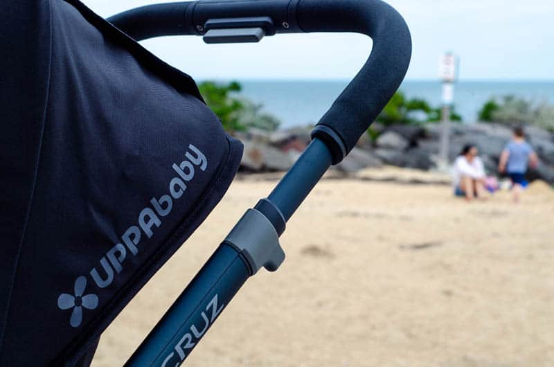 uppababy stroller on the beach in a sunny day