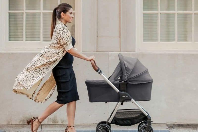 woman using nuna mixx stroller
