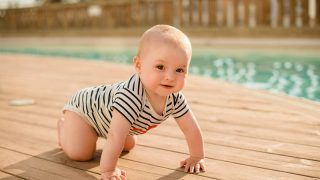 cute baby crawling by the pool