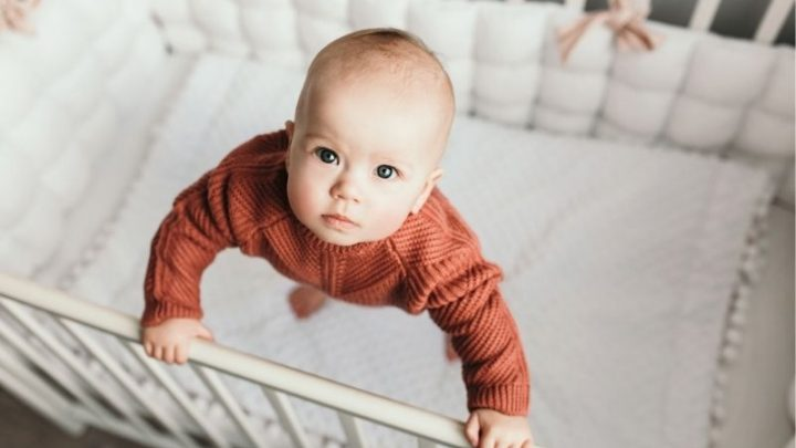 Baby Standing In Crib And Won't Sleep – Causes And Solutions