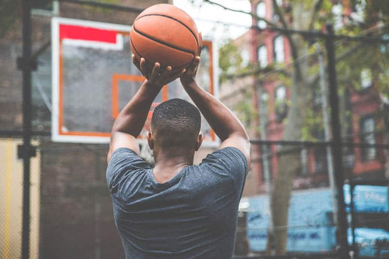 Basketball player training on a court