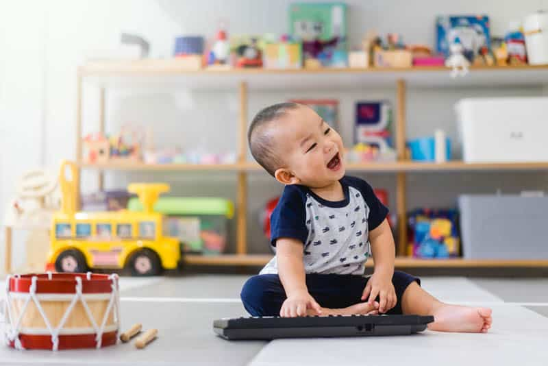 Little baby boy play keyboard and drum at home