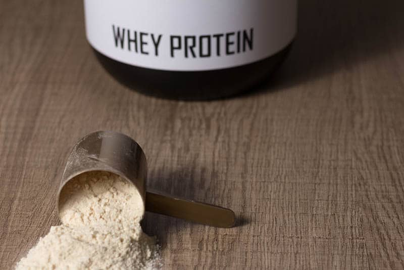 Whey protein food supplement for training on the table