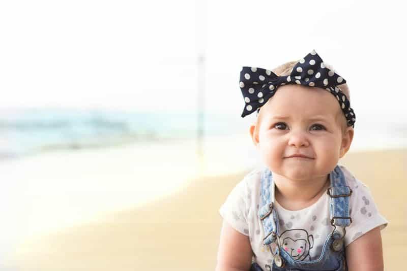 adorable baby girl wearing headband outdoor