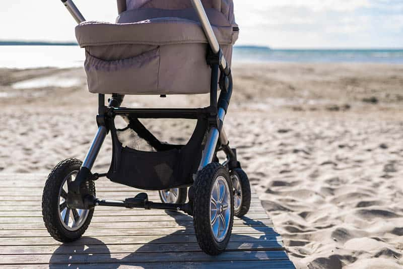 baby strollers on the beach in a sunny day
