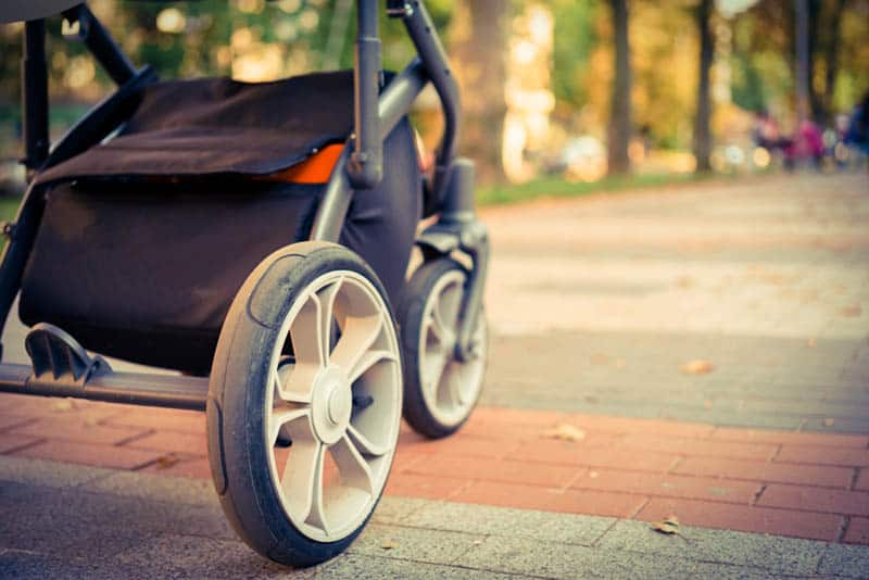 baby strollers wheels on the pram in the park