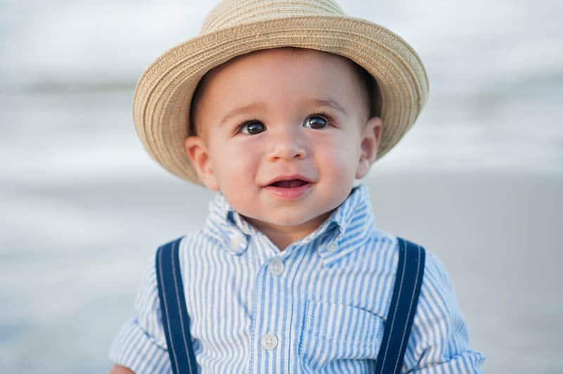 cute little boy wearing a shirt and hat outdoor