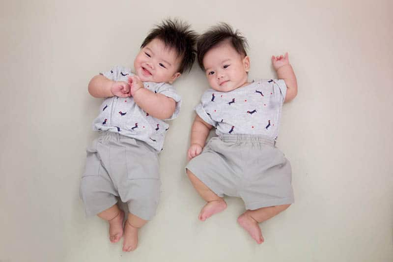 cute twin baby boys wearing the same clothes