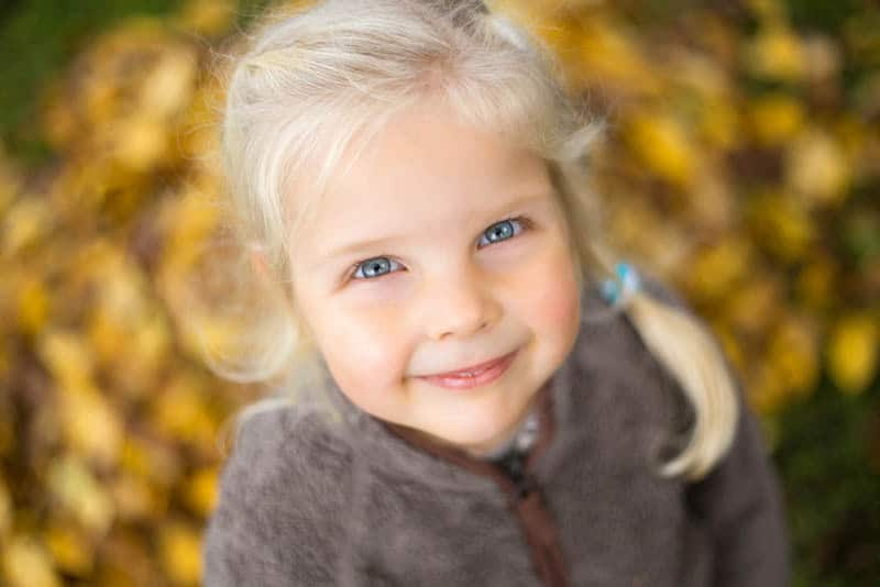 sweet little girl with blue eyes looking up