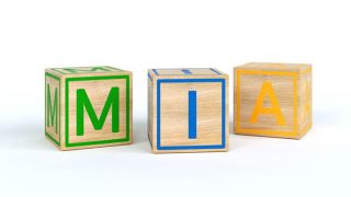 colorful toy blocks spelling out the name Mia