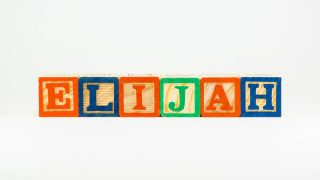 the name Elijah spelled out with colorful wooden blocks