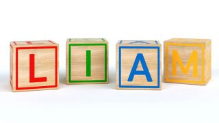 colorful toy blocks spelling out the name Liam