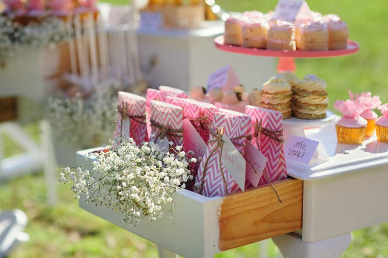 Dessert table with cakes decorated for a baby shower at farm
