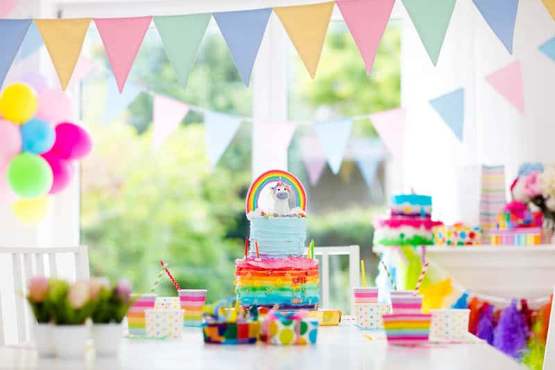 Room with festive balloons, colorful banners for a baby shower