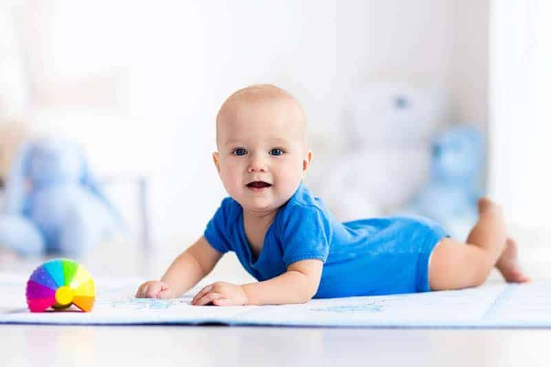 baby boy lying on his tummy
