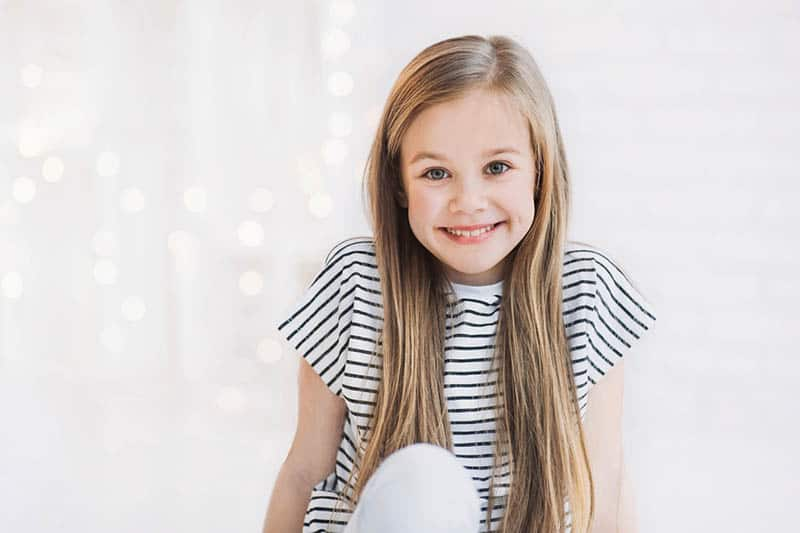 beautiful little girl smiling and looking at camera