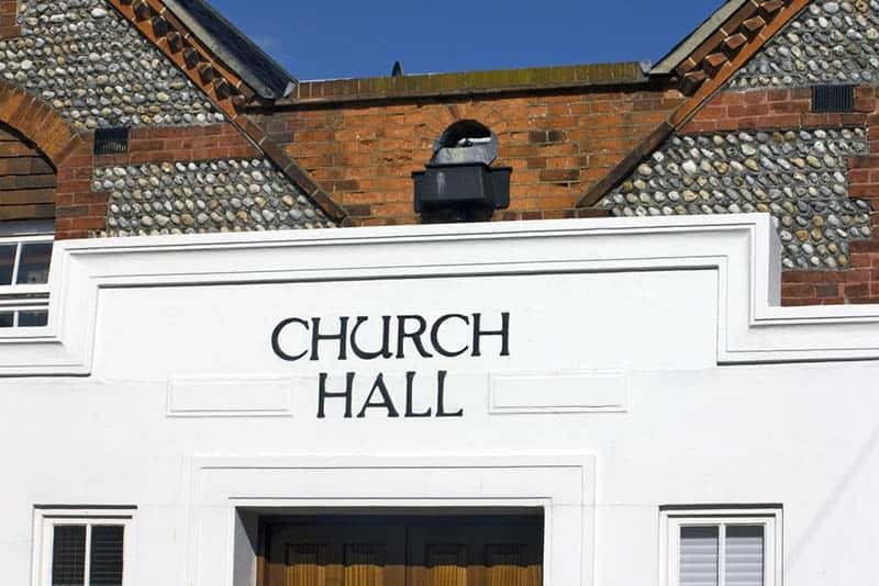building of a church hall on a sunny day