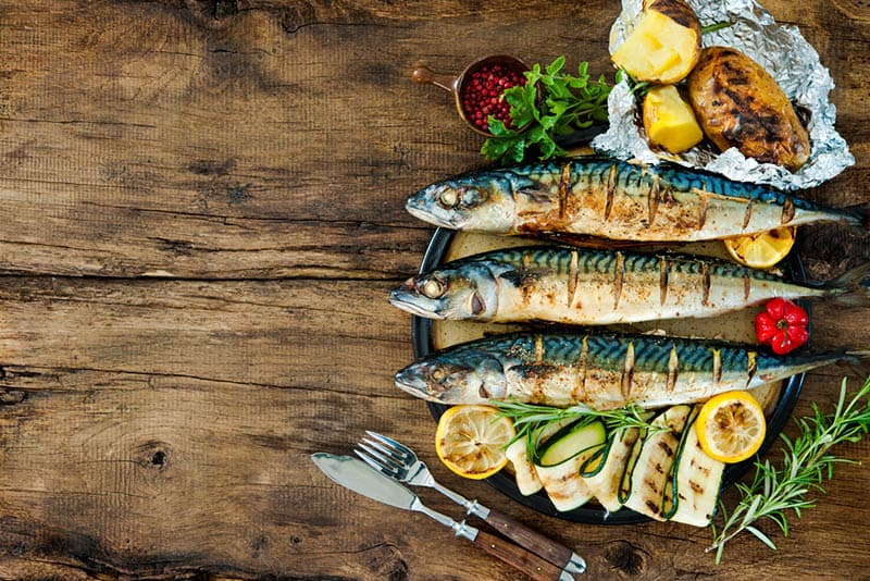 grilled fish served on the wooden table