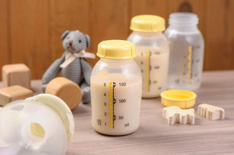 two bottle of mother breast milk on the table