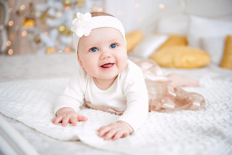 Baby girl wearing cute dress and headband