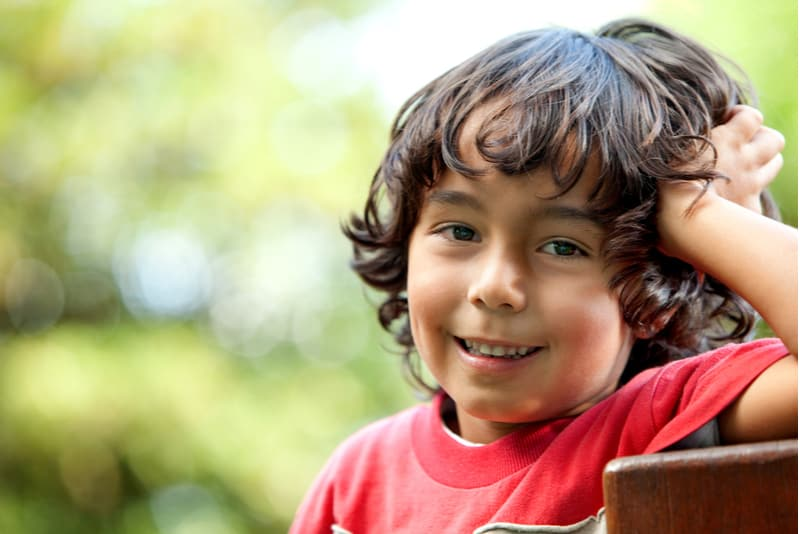 Little boy in the park smiling