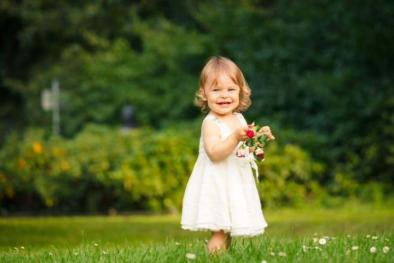 Little girl walking in the park