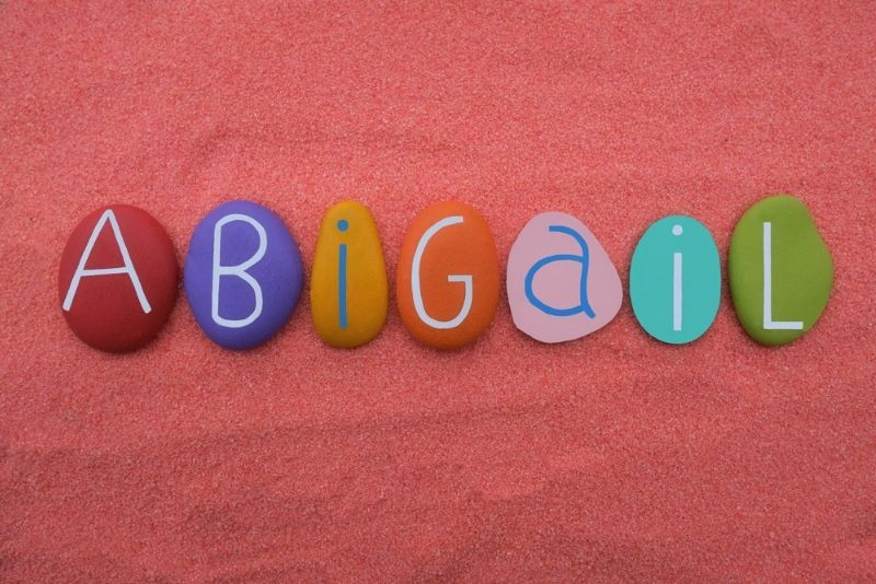 Female name Abigail written with multicolored stone letter