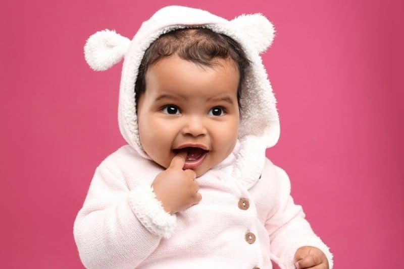 cute baby girl in a funny hat