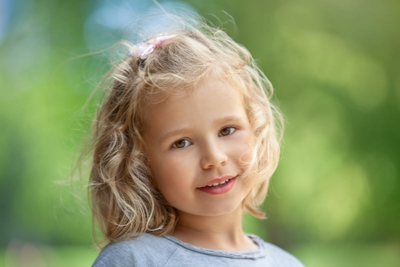 Smiling cute little girl outdoors