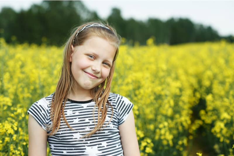 beautiful little girl in a field