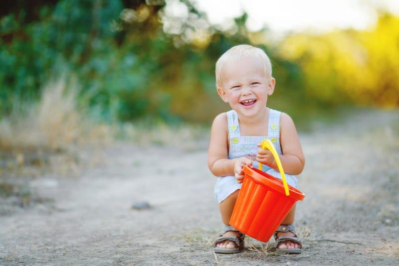 cute little blond boy outdoors