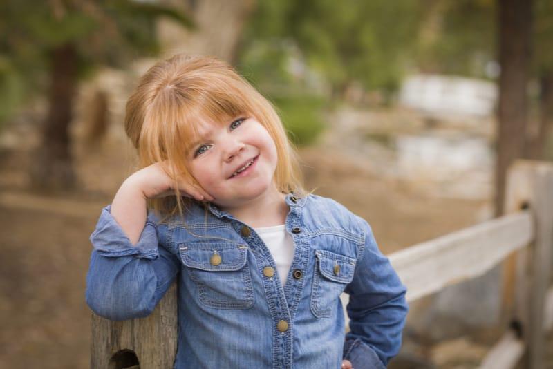 cute little girl posing outdoors