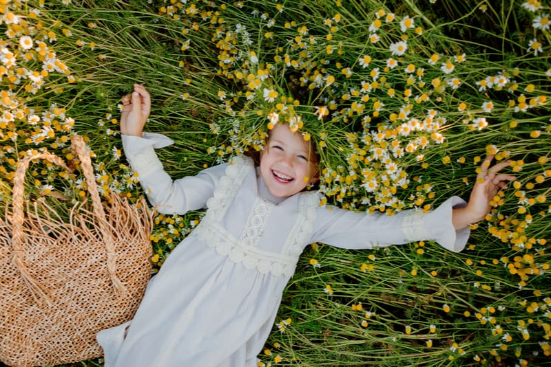 happy little girl in a cotton dress